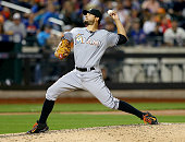 Brad Hand of the Miami Marlins delivers a pitch in the eighth inning against the New York Mets on April 18 2015 at Citi Field in the Flushing...