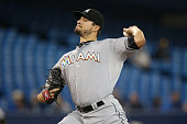 Brad Hand of the Miami Marlins delivers a pitch in the first inning during MLB game action against the Toronto Blue Jays on June 8 2015 at Rogers...