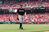 Brad Hand of the Miami Marlins leaves the game after giving up a grand slam home run to Devin Mesoraco of the Cincinnati Reds in the fifth inning of...