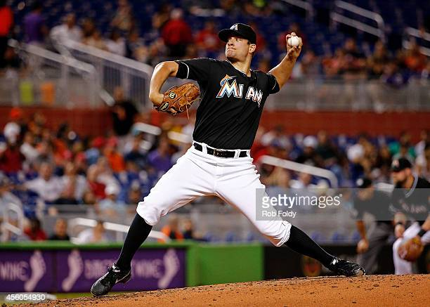 Brad Hand of the Miami Marlins pitches during the third inning of the game against the Philadelphia Phillies at Marlins Park on September 24 2014 in...