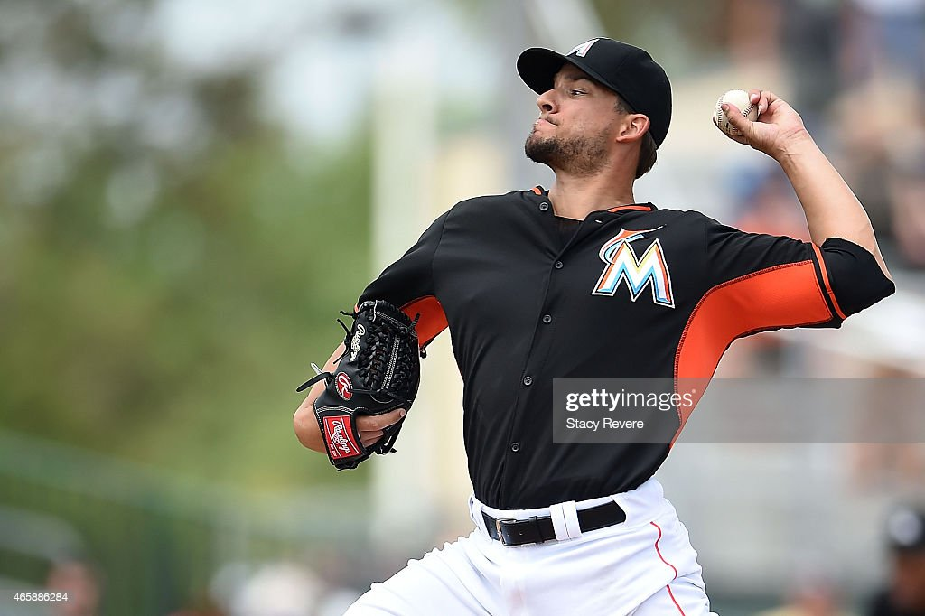Brad Hand of the Miami Marlins throws a pitch during the fourth inning of a spring training game against the New York Mets at Roger Dean Stadium on...