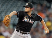 Brad Hand of the Miami Marlins throws in the first inning against the Houston Astros at Minute Maid Park on July 25 2014 in Houston Texas