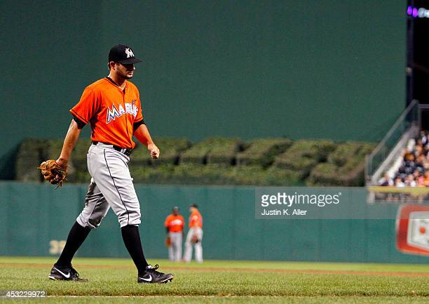 Brad Hand of the Miami Marlins walks off the field in the seventh inning after giving up an RBI single against the Pittsburgh Pirates during the game...