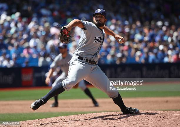 Brad Hand of the San Diego Padres delivers a pitch in the seventh inning during MLB game action against the Toronto Blue Jays on July 27 2016 at...
