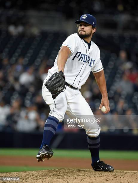 Brad Hand of the San Diego Padres pitches during the eighth inning of a baseball game against the Milwaukee Brewers at PETCO Park on May 17 2017 in...
