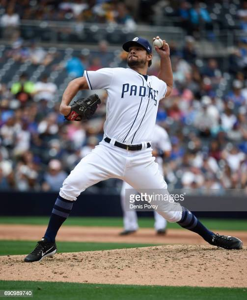 Brad Hand of the San Diego Padres pitches during the eighth inning of a baseball game against the Chicago Cubs at PETCO Park on May 31 2017 in San...