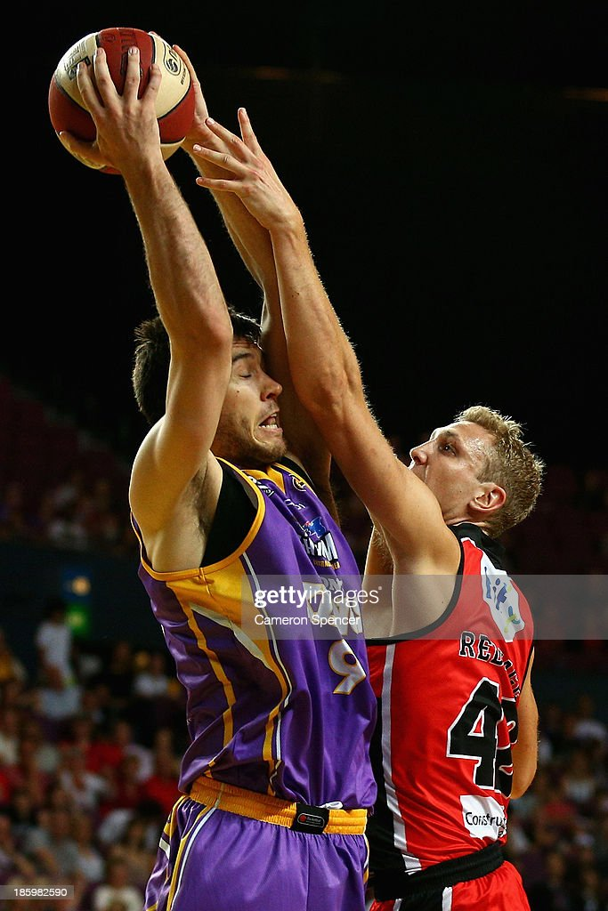 Brad Hill of the Kings is blocked by Shawn Redhage of the Wildcats during the round three NBL match between the Sydney Kings and the Perth Wildcats at Sydney Entertainment Centre in October 27, 2013 in Sydney, Australia.