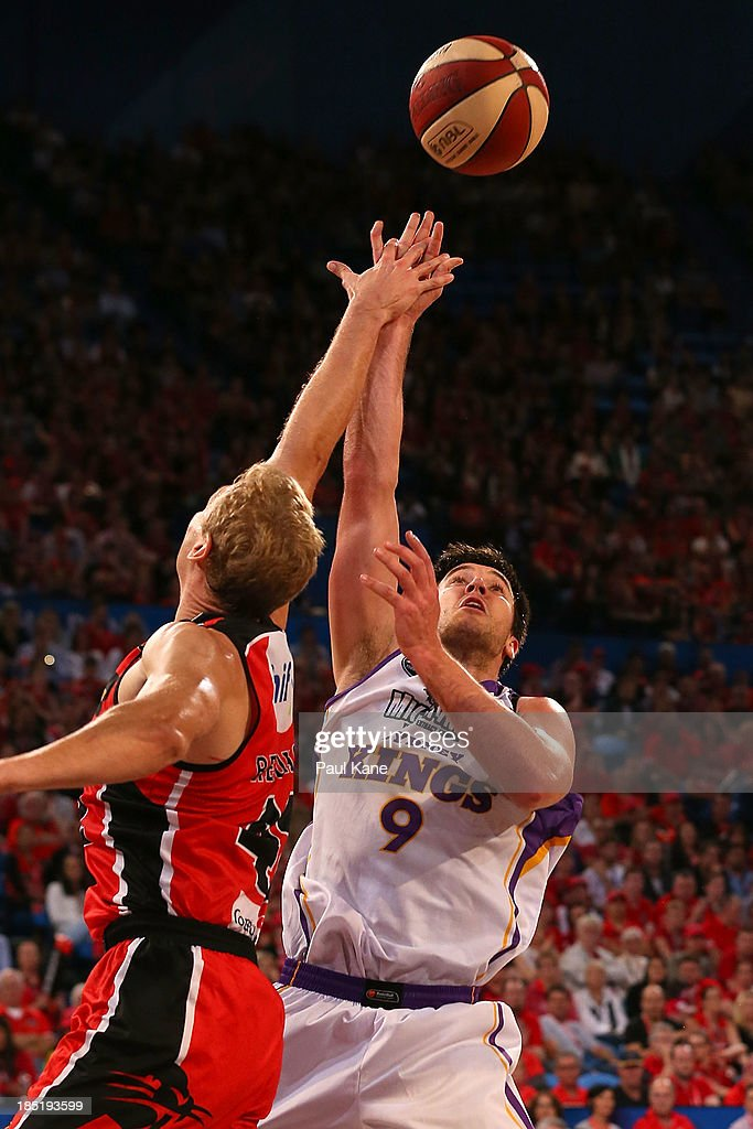 Brad Hill of the Kings shoots against Shawn Redhage of the Wildcats during the round two NBL match between the Perth Wildcats and the Sydney Kings at Perth Arena in October 18, 2013 in Perth, Australia.