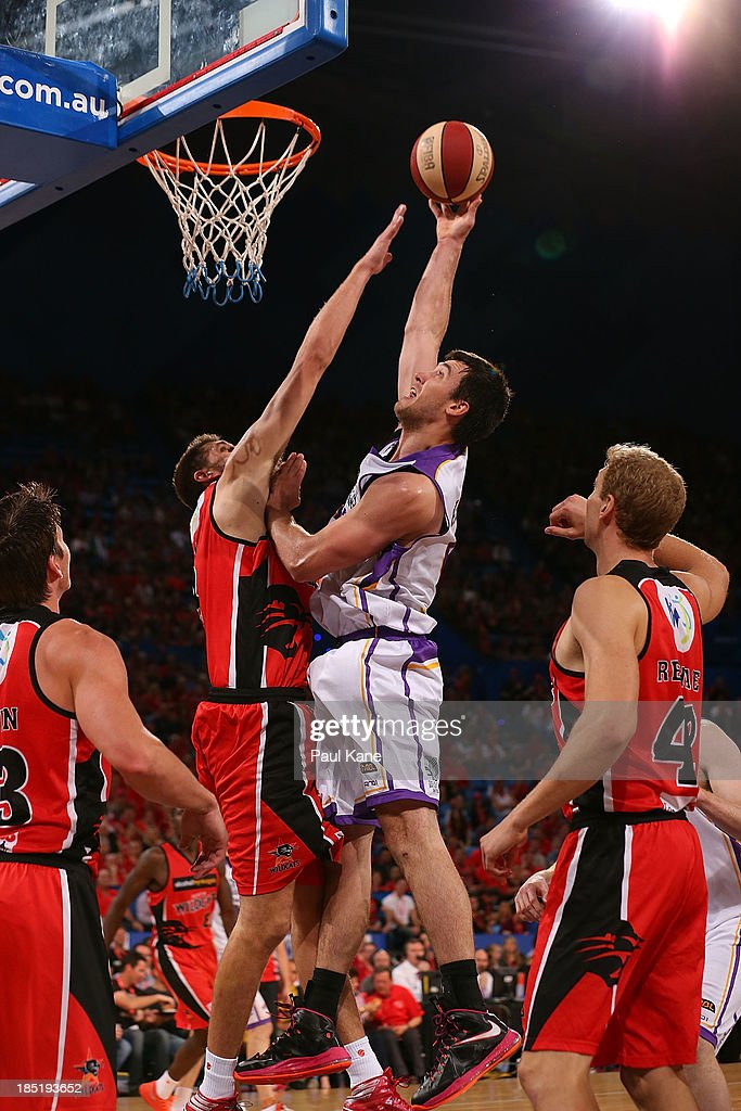 Brad Hill of the Kings shoots against Tom Jervis of the Wildcats during the round two NBL match between the Perth Wildcats and the Sydney Kings at Perth Arena in October 18, 2013 in Perth, Australia.