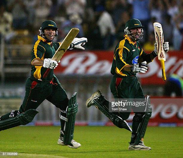 Brad Hodge and Jeremy Snape of Leicestershire celebrate during the Surrey v Leicestershire Twenty20 cup Final match at Edgbaston Cricket Ground on...