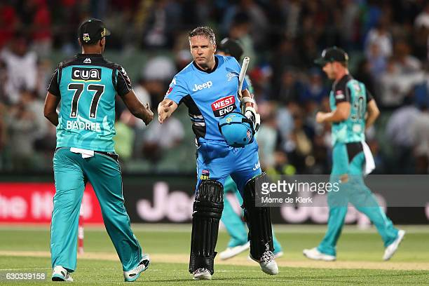 Brad Hodge of the Adelaide Strikers shakes hands with Samuel Badree of the Brisbane Heat after the Big Bash League match between the Adelaide...