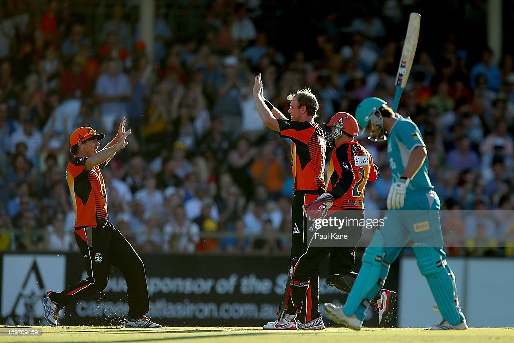 Brad Hogg and Michael Beer celebrate the wicket of Joe Burns of the Heat during the Big Bash League final match between the Perth Scorchers and the Brisbane Heat at the WACA on January 19, 2013 in Perth, Australia.