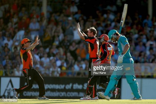 Brad Hogg and Michael Beer celebrate the wicket of Joe Burns of the Heat during the Big Bash League final match between the Perth Scorchers and the...