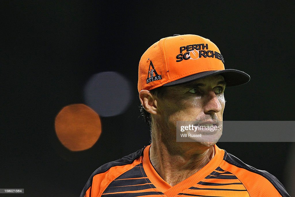<a gi-track='captionPersonalityLinkClicked' href=/galleries/search?phrase=Brad+Hogg&family=editorial&specificpeople=211604 ng-click='$event.stopPropagation()'>Brad Hogg</a> looks on from the outer field during the Big Bash League match between the Perth Scorchers and Adelaide Strikers at WACA on December 9, 2012 in Perth, Australia.