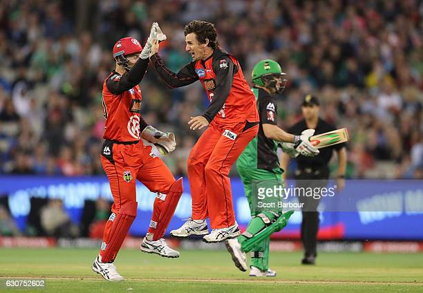 Brad Hogg of the Renegades is congratulated by his teammates after dismissing David Hussey of the Stars during the Big Bash League match between the...