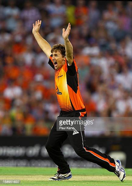 Brad Hogg of the Scorchers appeals for the wicket of Scott Coyte of the Thunder during the Big Bash League match between the Perth Scorchers and the...