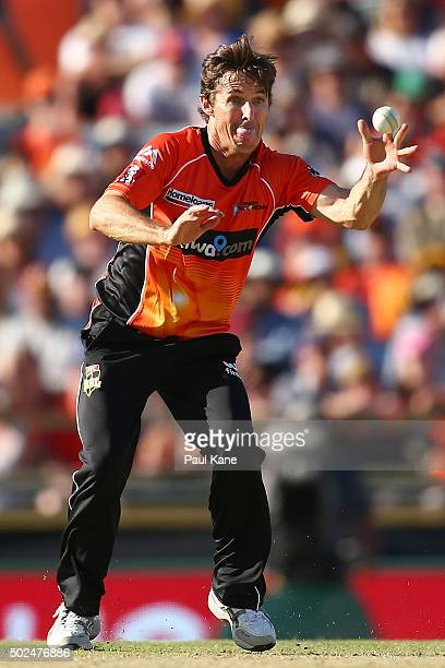 Brad Hogg of the Scorchers attempts to catch Jason Floros of the Heat during the Big Bash League match between the Perth Scorchers and the Brisbane...