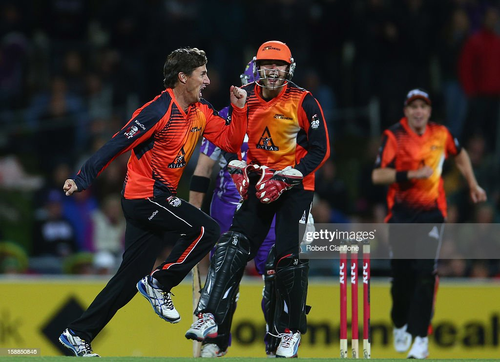 <a gi-track='captionPersonalityLinkClicked' href=/galleries/search?phrase=Brad+Hogg&family=editorial&specificpeople=211604 ng-click='$event.stopPropagation()'>Brad Hogg</a> of the Scorchers celebrates the wicket of Travis Birt of the Hurricanes during the Big Bash League match between the Hobart Hurricanes and the Perth Scorchers at Blundstone Arena on January 1, 2013 in Hobart, Australia.