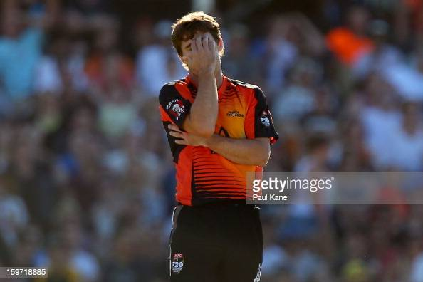 Brad Hogg of the Scorchers reacts after being hit for six during the Big Bash League final match between the Perth Scorchers and the Brisbane Heat at...