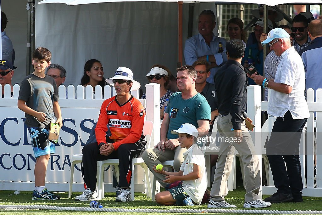 Brad Hogg of the Scorchers takes a seat in with the corporates while fielding during the WA Festival of Cricket Legends Match between the Australian Legends XI and Perth Scorchers at Aquinas College on December 11, 2015 in Perth, Australia.
