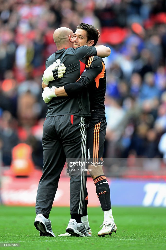 Brad Jones of Liverpool (R) celebrates with fellow goalkeeper Pepe Reina after the FA Cup with Budweiser Semi Final match between Liverpool and Everton at Wembley Stadium on April 14, 2012 in London, England.