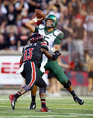 Brad Kaaya of the Miami Huricanes throws a pass during the game against the Louisville Cardinals at Papa John's Cardinal Stadium on September 1 2014...