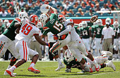 Brad Kaaya of the Miami Hurricanes is sacked by Kevin Dodd of the Clemson Tigers during a game at Sun Life Stadium on October 24 2015 in Miami...