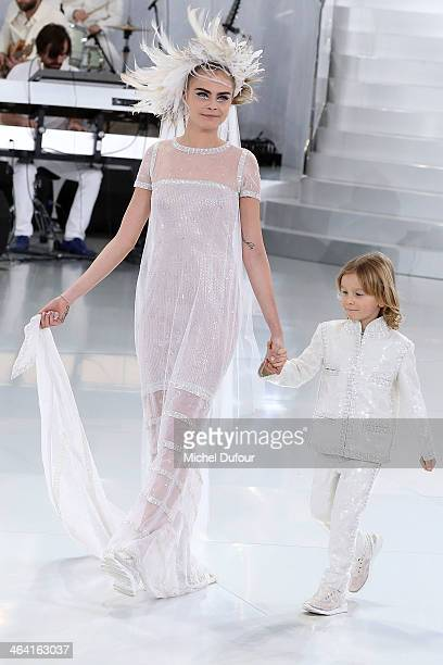 Brad Keening and Cara Delevingne walk the runway for final during the Chanel show as part of Paris Fashion Week HauteCouture Spring/Summer 2014 on...