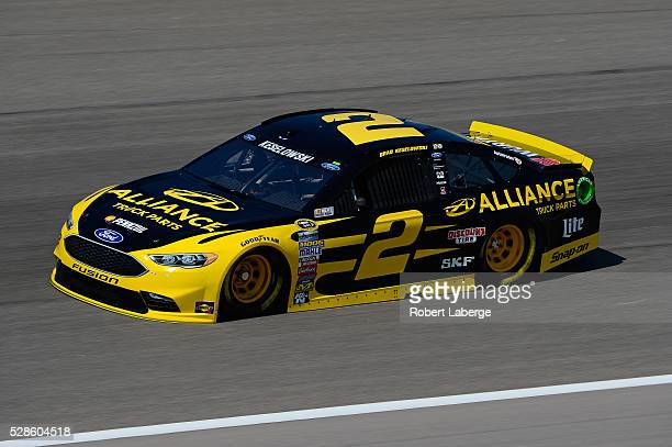 Brad Keselowski driver of the Alliance Truck Parts Ford drives during practice for the NASCAR Sprint Cup Series Go Bowling 400 at Kansas Speedway on...