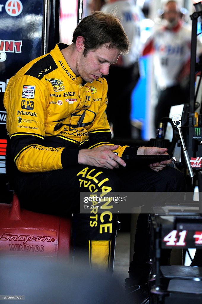Brad Keselowski, driver of the #2 Alliance Truck Parts Ford, looks on during practice for the NASCAR Sprint Cup Series Go Bowling 400 at Kansas Speedway on May 6, 2016 in Kansas City, Kansas.