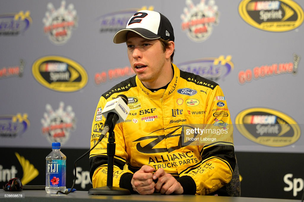 Brad Keselowski, driver of the #2 Alliance Truck Parts Ford, speaks to the media before qualifying for the NASCAR Sprint Cup Series Go Bowling 400 at Kansas Speedway on May 6, 2016 in Kansas City, Kansas.