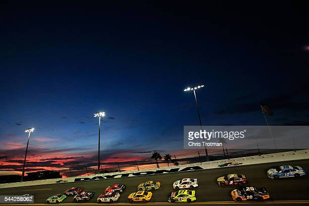 Brad Keselowski driver of the Detroit Genuine Parts Ford leads a pack of cars during the NASCAR Sprint Cup Series Coke Zero 400 Powered By CocaCola...