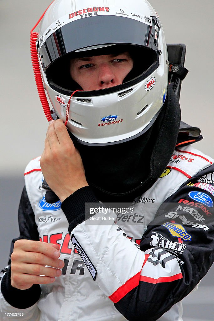 Brad Keselowski, driver of the #22 Discount Tire Ford, adjusts his helmet in the garage area during practice for the NASCAR Nationwide Series Food City 250 at Bristol Motor Speedway on August 23, 2013 in Bristol, Tennessee.