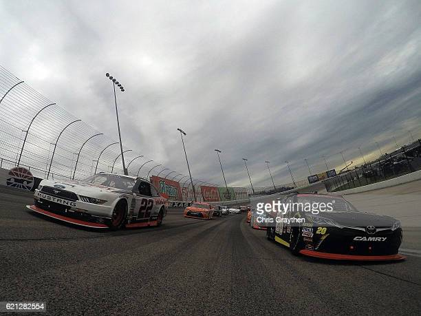 Brad Keselowski driver of the Discount Tire Ford and Erik Jones driver of the GameStop/Call of Duty Toyota lead the field during the pace lap prior...