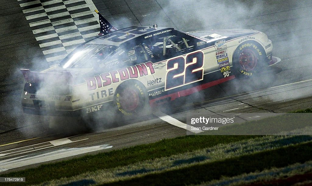 <a gi-track='captionPersonalityLinkClicked' href=/galleries/search?phrase=Brad+Keselowski&family=editorial&specificpeople=890258 ng-click='$event.stopPropagation()'>Brad Keselowski</a>, driver of the #22 Discount Tire Ford, celebrates after winning the NASCAR Nationwide Series U.S. Cellular 250 Presented by Enlist Weed Control System at Iowa Speedway on August 3, 2013 in Newton, Iowa.