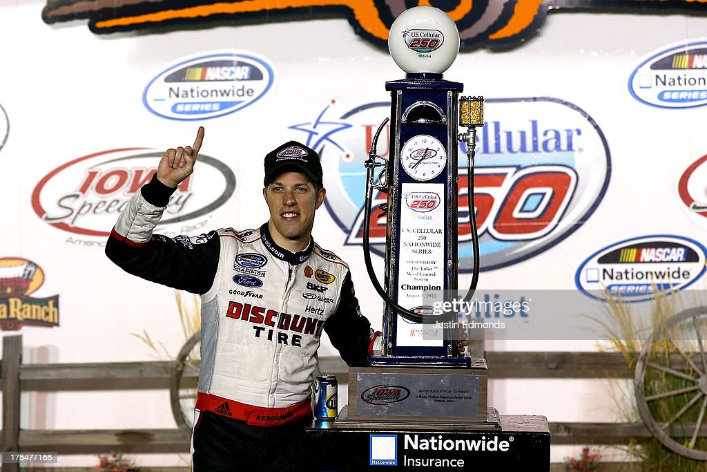 Brad Keselowski, driver of the #22 Discount Tire Ford, celebrates in victory lane after winning the NASCAR Nationwide Series U.S. Cellular 250 Presented by Enlist Weed Control System at Iowa Speedway on August 3, 2013 in Newton, Iowa.