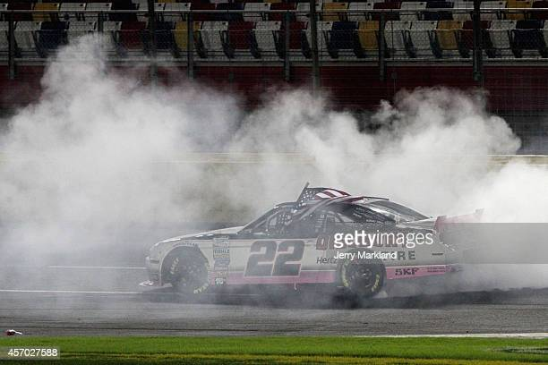 Brad Keselowski driver of the Discount Tire Ford celebrates with a burnout after winning the NASCAR Nationwide Series Drive For The Cure 300...