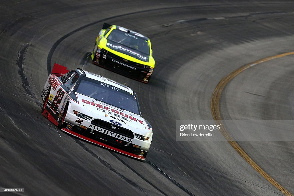 Brad Keselowski driver of the Discount Tire Ford leads Paul Menard driver of the Richmond/Menards Chevrolet during the NASCAR XFINITY Series Kentucky...