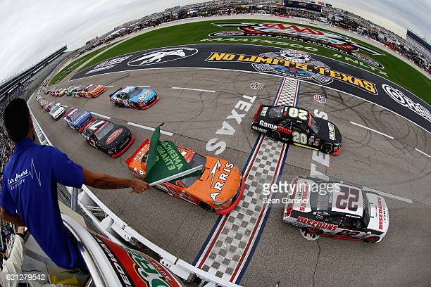 Brad Keselowski driver of the Discount Tire Ford leads the field past the green flag to start the NASCAR XFINITY Series O'Reilly Auto Parts Challenge...