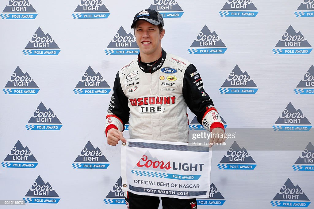 Brad Keselowski, driver of the #22 Discount Tire Ford, poses with the Coors Light Pole Award after qualifying for pole position for the NASCAR XFINITY Series O'Reilly Auto Parts Challenge at Texas Motor Speedway on November 5, 2016 in Fort Worth, Texas.