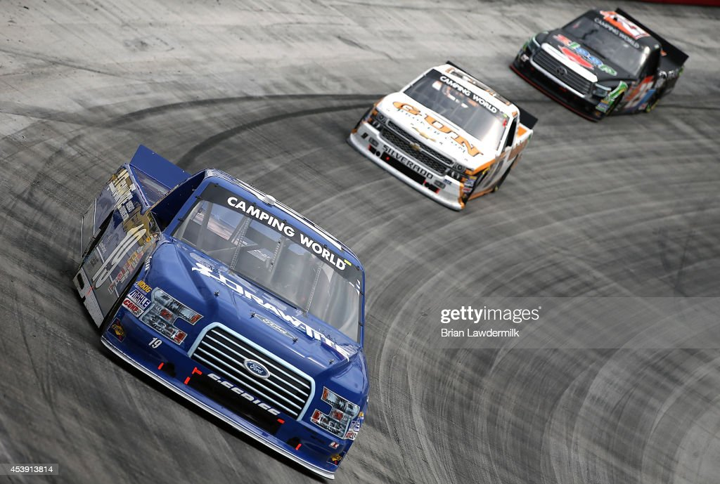<a gi-track='captionPersonalityLinkClicked' href=/galleries/search?phrase=Brad+Keselowski&family=editorial&specificpeople=890258 ng-click='$event.stopPropagation()'>Brad Keselowski</a>, driver of the #19 DrawTite Ford, leads during the NASCAR Camping World Truck Series UNOH 200 presented by ZLOOP at Bristol Motor Speedway on August 21, 2014 in Bristol, Tennessee.