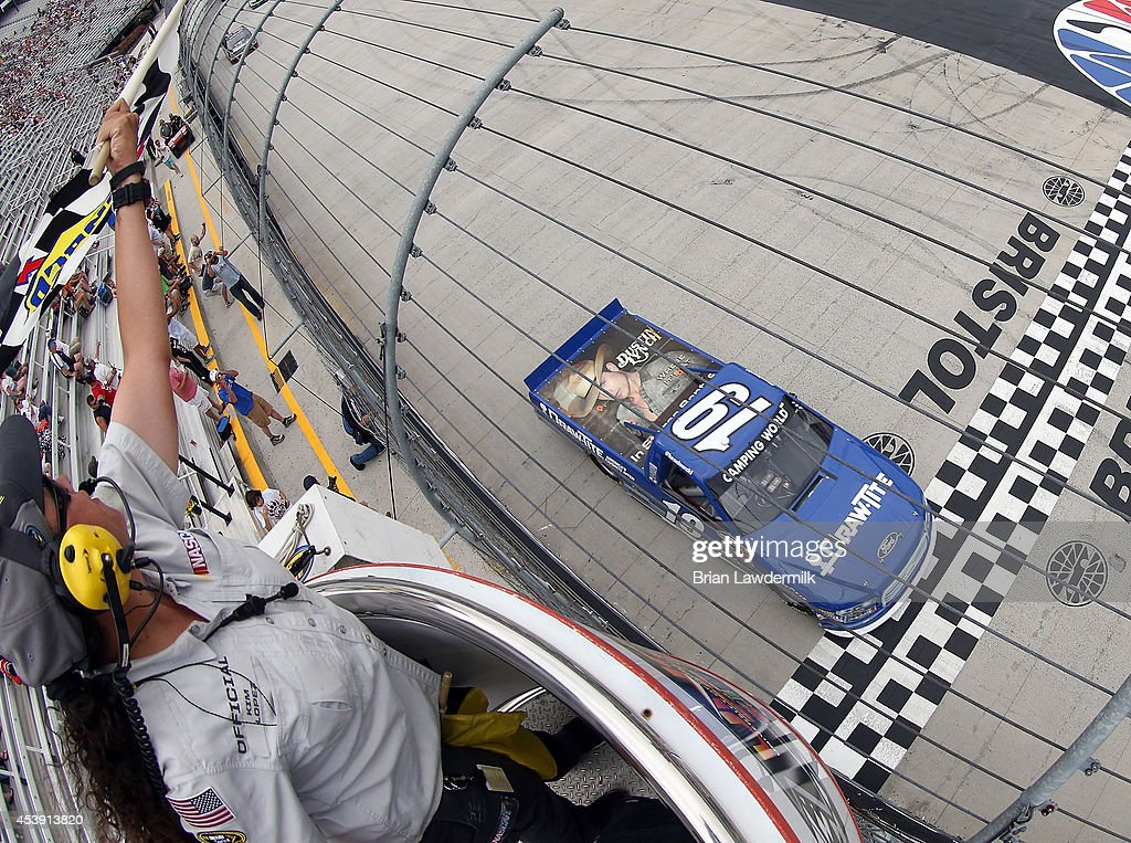 <a gi-track='captionPersonalityLinkClicked' href=/galleries/search?phrase=Brad+Keselowski&family=editorial&specificpeople=890258 ng-click='$event.stopPropagation()'>Brad Keselowski</a>, driver of the #19 DrawTite Ford, wins the NASCAR Camping World Truck Series UNOH 200 presented by ZLOOP at Bristol Motor Speedway on August 21, 2014 in Bristol, Tennessee.