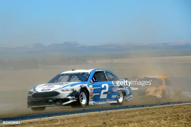 Brad Keselowski driver of the Freightliner Elite Support Ford races during the Monster Energy NASCAR Cup Series Toyota/Save Mart 350 at Sonoma...