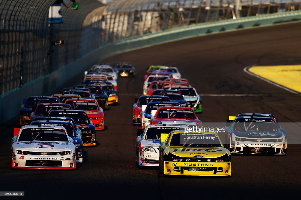 Brad Keselowski driver of the Hertz Ford and Kyle Larson driver of the Cartwheel by Target Chevrolet lead the field on the first lap during the...
