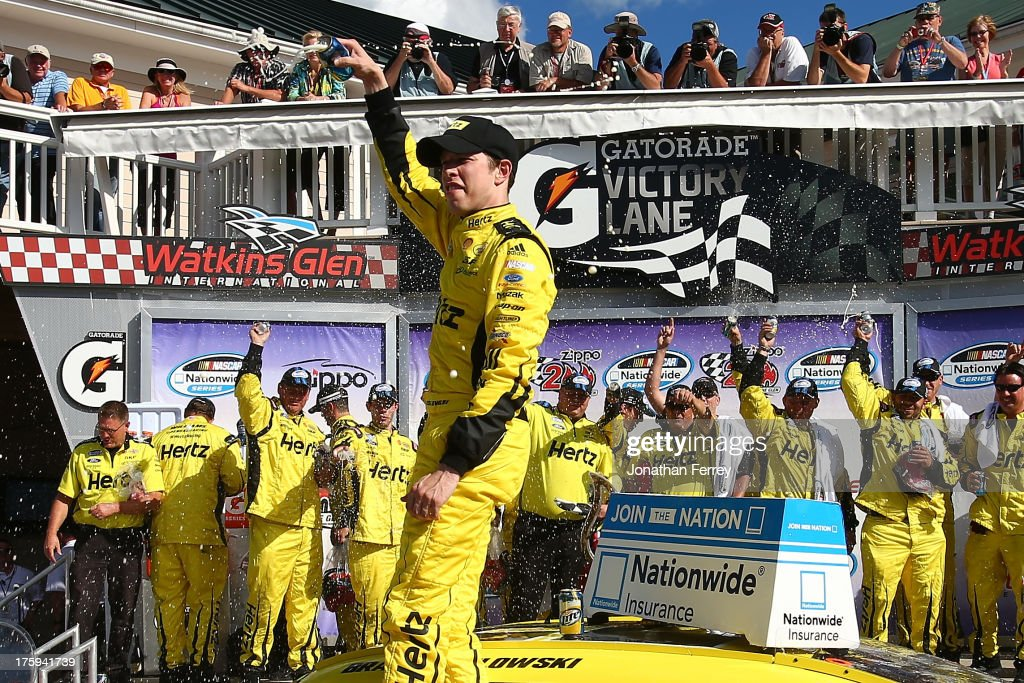 <a gi-track='captionPersonalityLinkClicked' href=/galleries/search?phrase=Brad+Keselowski&family=editorial&specificpeople=890258 ng-click='$event.stopPropagation()'>Brad Keselowski</a>, driver of the #22 Hertz Ford, celebrates in victory lane after winning the NASCAR Nationwide Series Zippo 200 at Watkins Glen International on August 10, 2013 in Watkins Glen, New York.