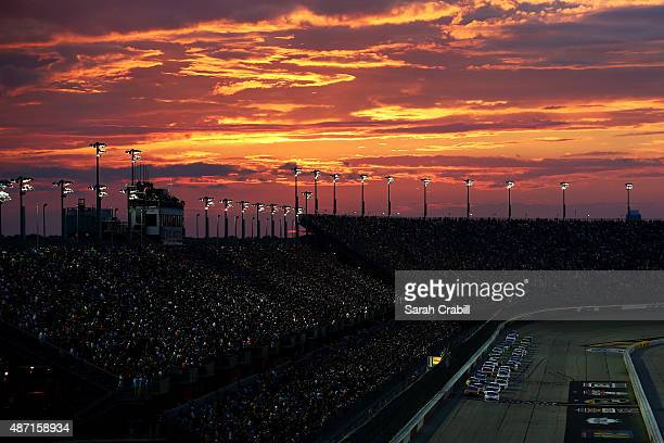 Brad Keselowski driver of the Miller High Life Ford and Kevin Harvick driver of the Budweiser/Jimmy John's Chevrolet lead the field to a restart...