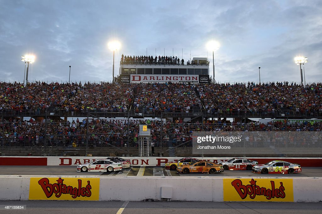 Brad Keselowski driver of the Miller High Life Ford and Kurt Busch driver of the Haas Automation Chevrolet lead the field to the green flag for the...
