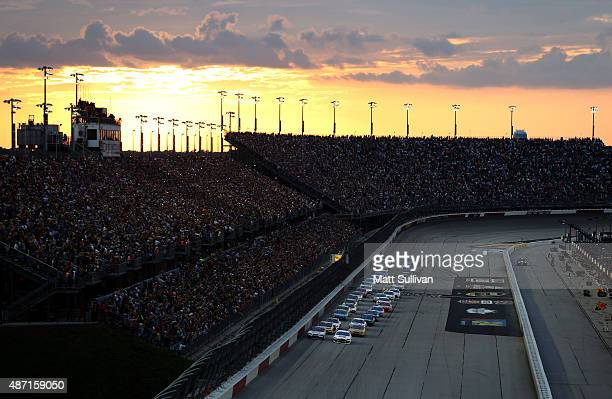 Brad Keselowski driver of the Miller High Life Ford and Kurt Busch driver of the Haas Automation Chevrolet lead the field to turn one to start the...
