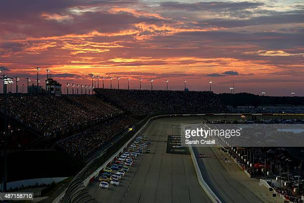 Brad Keselowski driver of the Miller High Life Ford leads the field on a restart during the NASCAR Sprint Cup Series Bojangles' Southern 500 at...