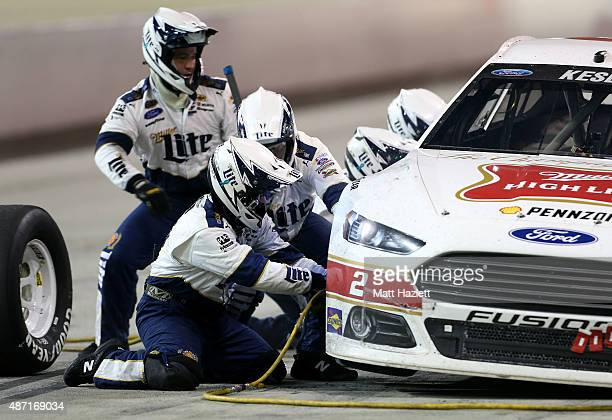 Brad Keselowski driver of the Miller High Life Ford pits during the NASCAR Sprint Cup Series Bojangles' Southern 500 at Darlington Raceway on...